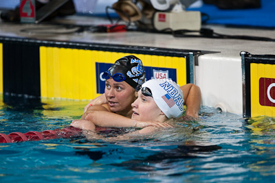 Elizabeth Beisel (L) and Elizabeth Pelton (R) share a look at the clock following a 1-2 finish and an opportunity to compete at the FINA Swimming World Championships at the 2009 ConocoPhillips USA National Swimming Championships and World Championship Trials